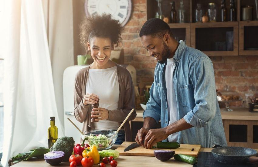 man women cooking