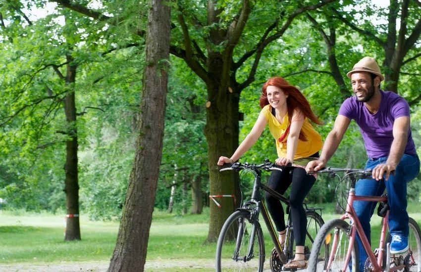 man and women cycling